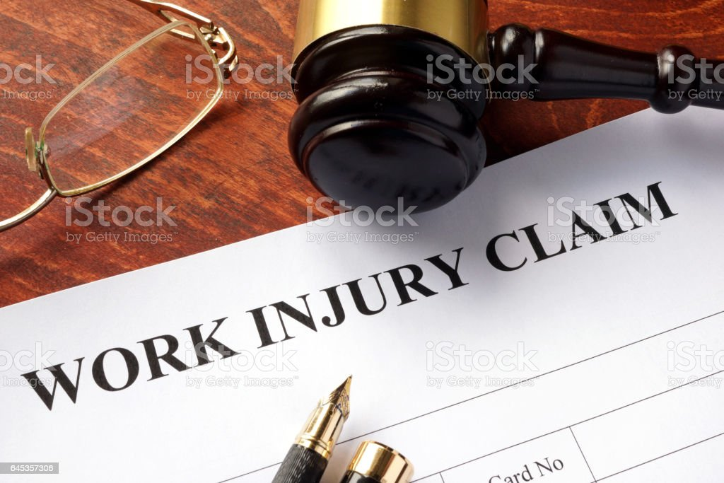 Worker compensation. Work injury claim on a table. stock photo