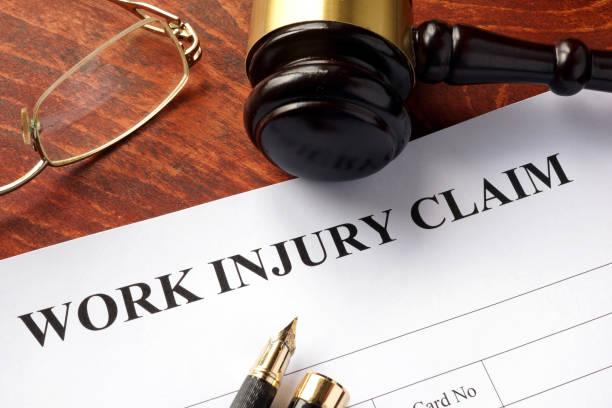 worker compensation. work injury claim on a table. - soddisfazione foto e immagini stock