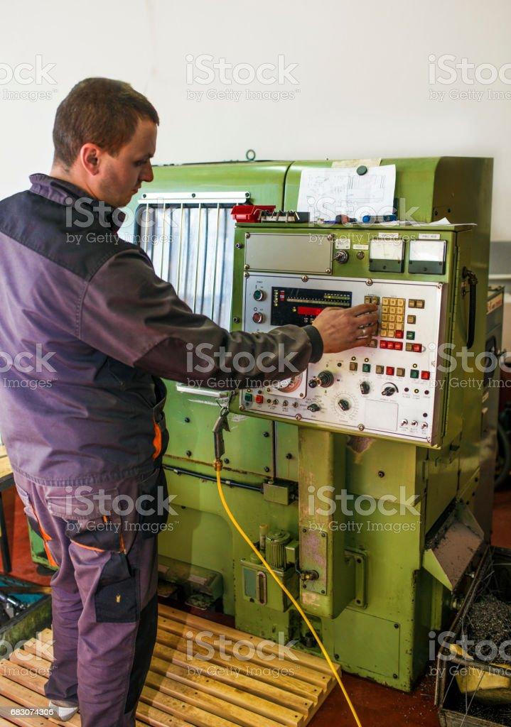 Worker control CNC machine production foto de stock royalty-free