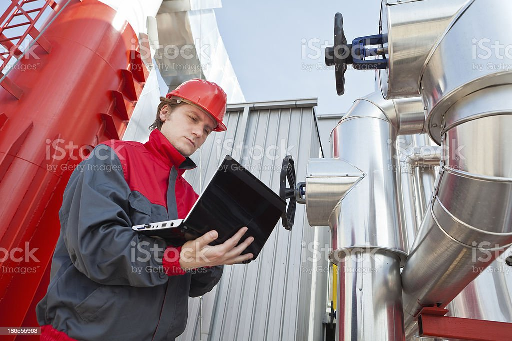 Worker control devices in a Heating Plant stock photo