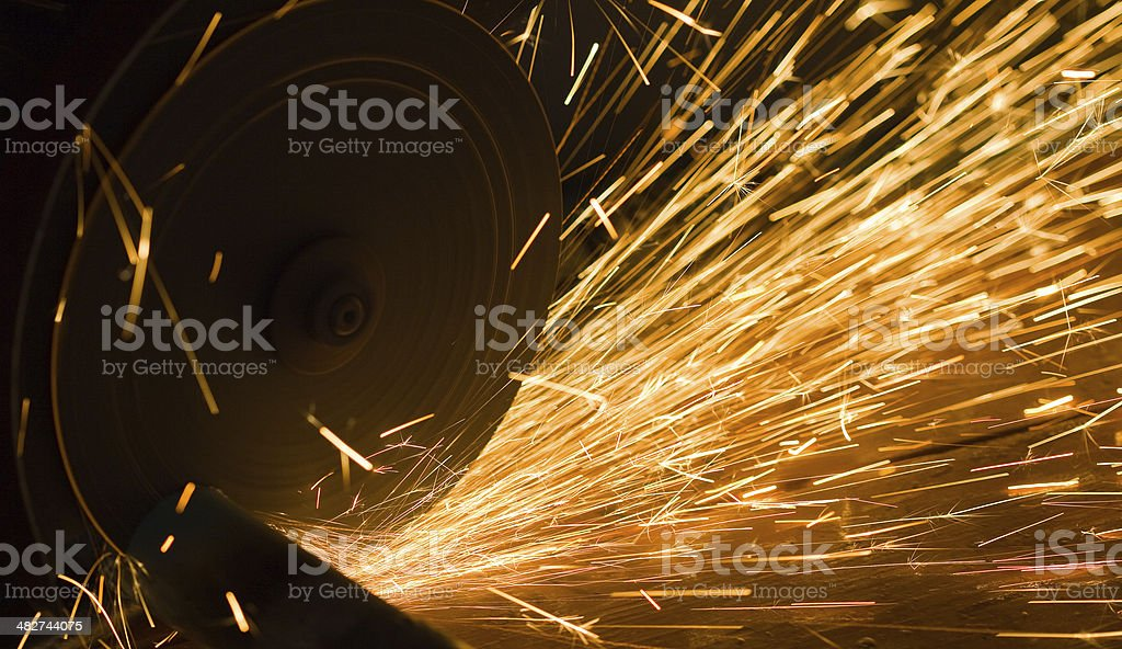 worker cuts a metal pipe stock photo