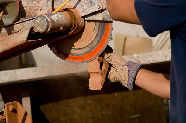 Worker cutting bricks stock photo