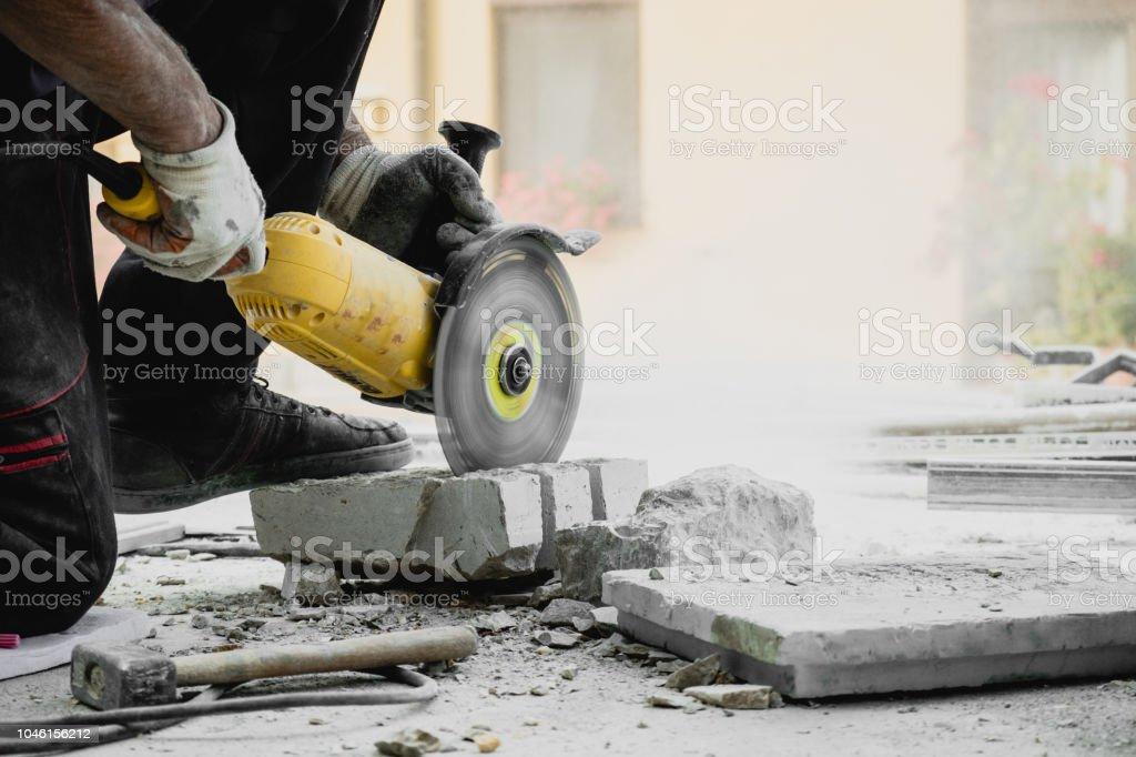 Worker cutting limestone stock photo
