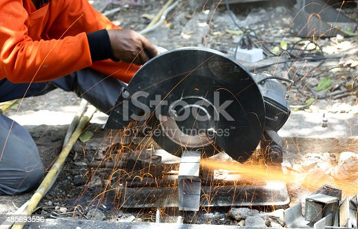 istock worker cutting metal  with saw disk 485693596