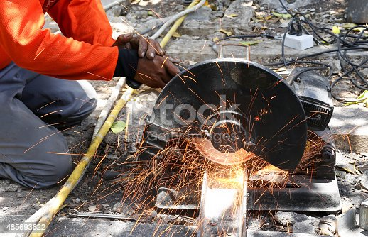 istock worker cutting metal  with saw disk 485693622