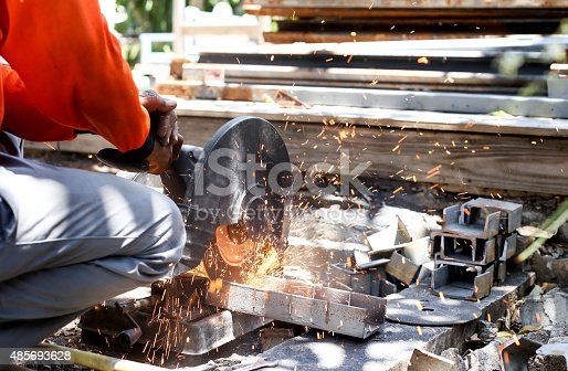 istock worker cutting metal  with saw disk 485693628