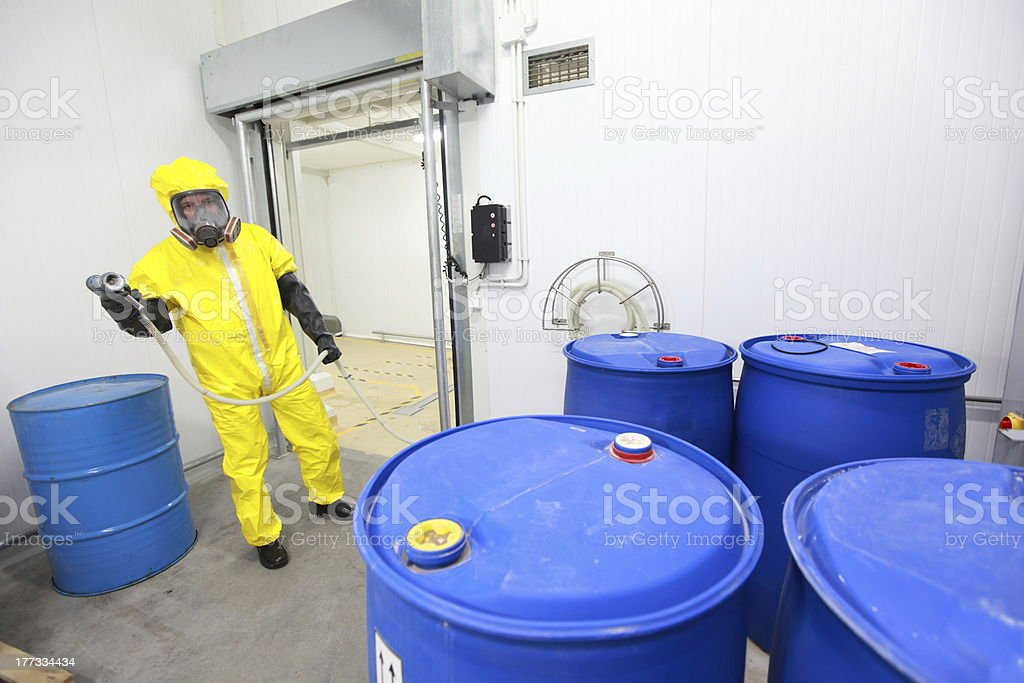worker dealing with toxic substance royalty-free stock photo