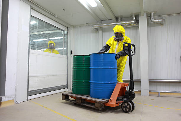 worker dealing with toxic waste stock photo