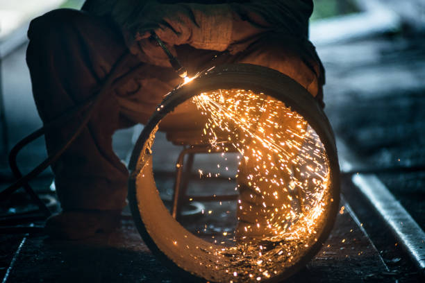Worker doing a industrial welding in a workshop stock photo