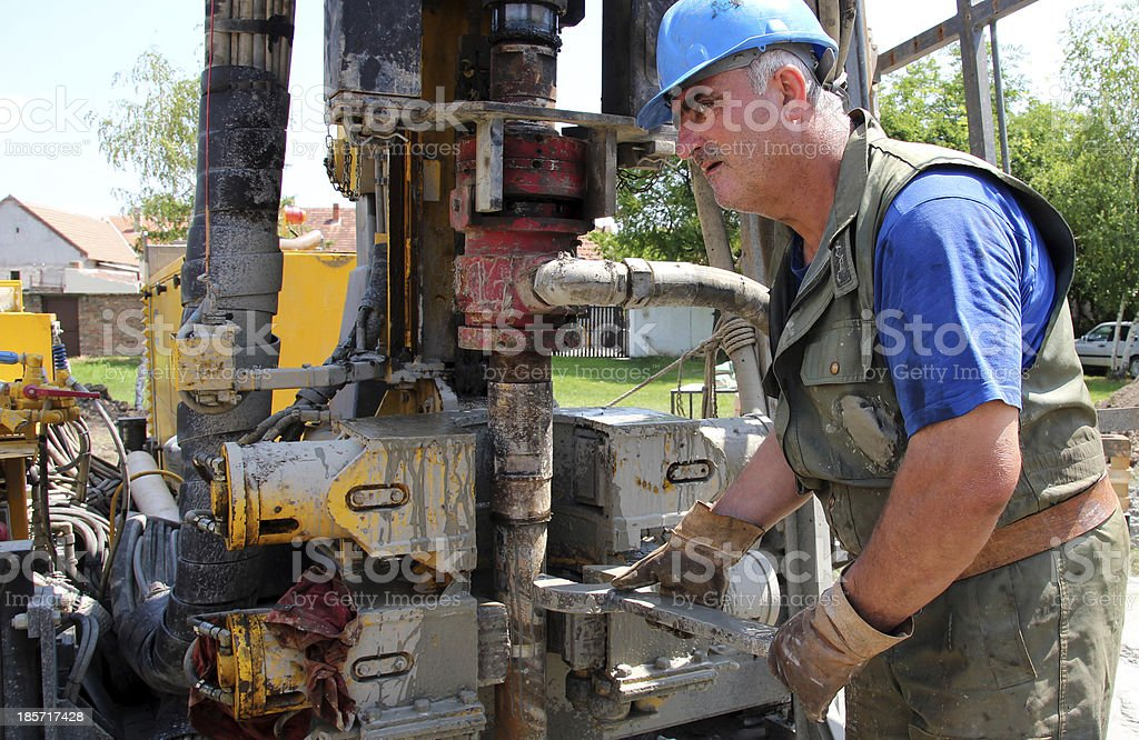 Worker Drilling For Oil on Rig royalty-free stock photo
