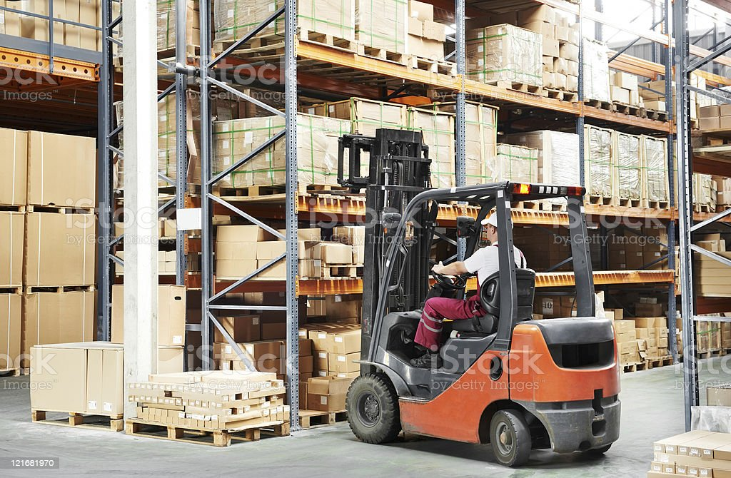 worker driver at warehouse forklift loader works royalty-free stock photo