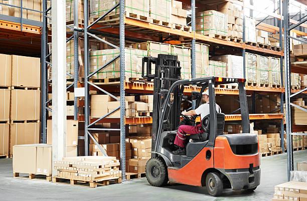 worker driver at warehouse forklift loader works stock photo