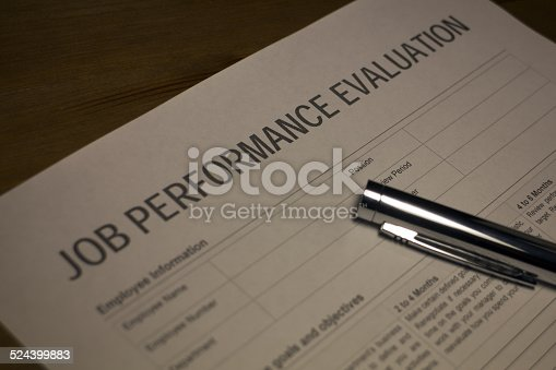 Someone filling out Job Performance Review document