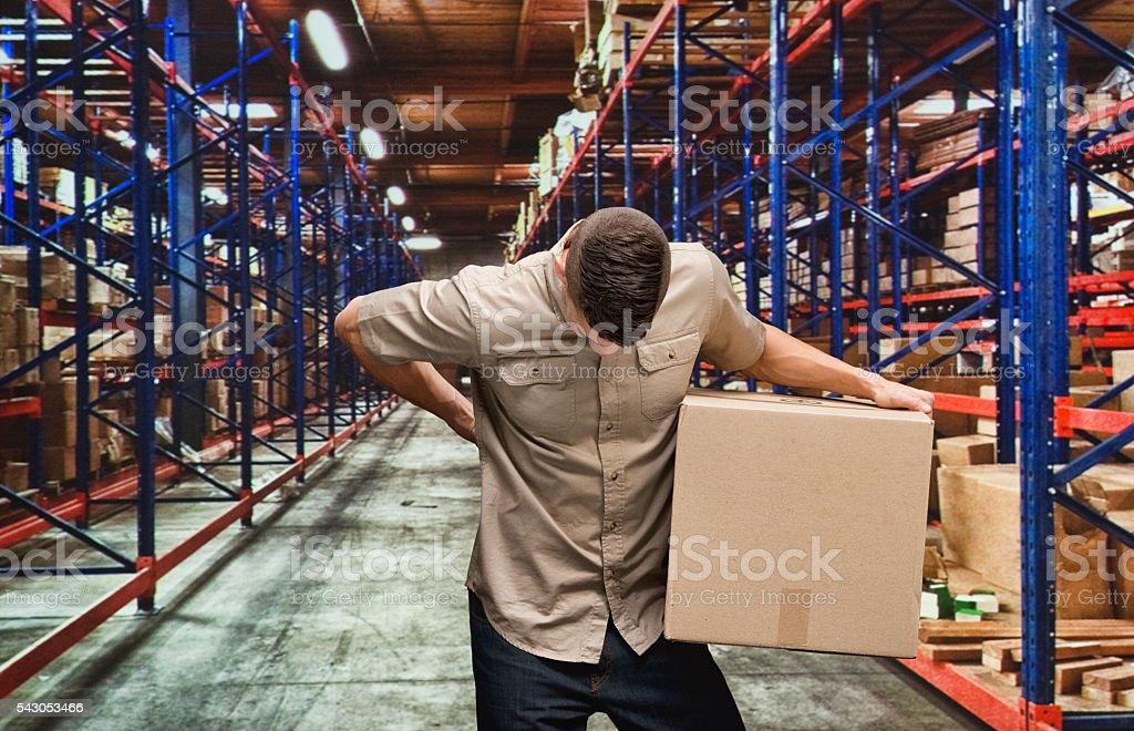 Arbeiter sich Rücken Schmerzen im lager – Foto