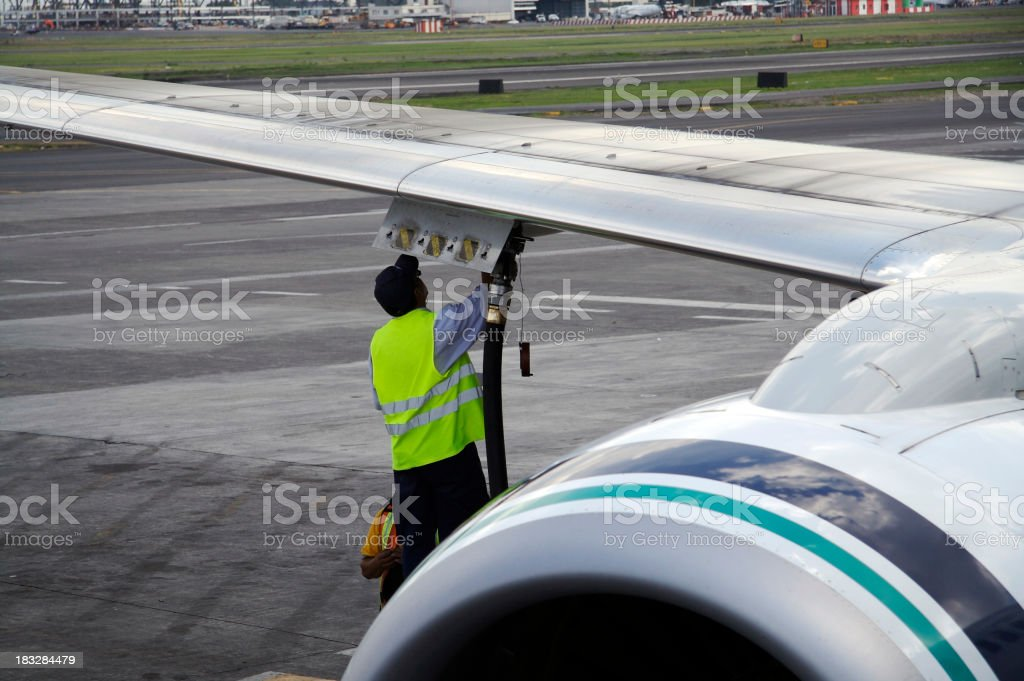 worker fueling jet stock photo