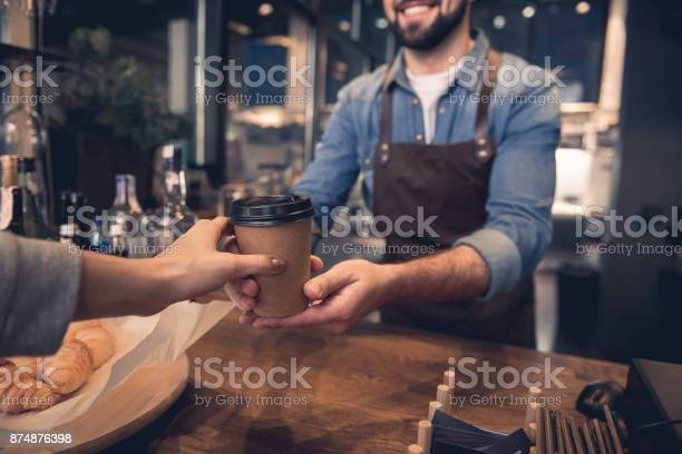 Worker giving mug of beverage to woman picture id874876398?b=1&k=6&m=874876398&s=612x612&h=dxpk gnrwqlf2btnkim3x1b4atn93ne vhgfeu9iwrw=