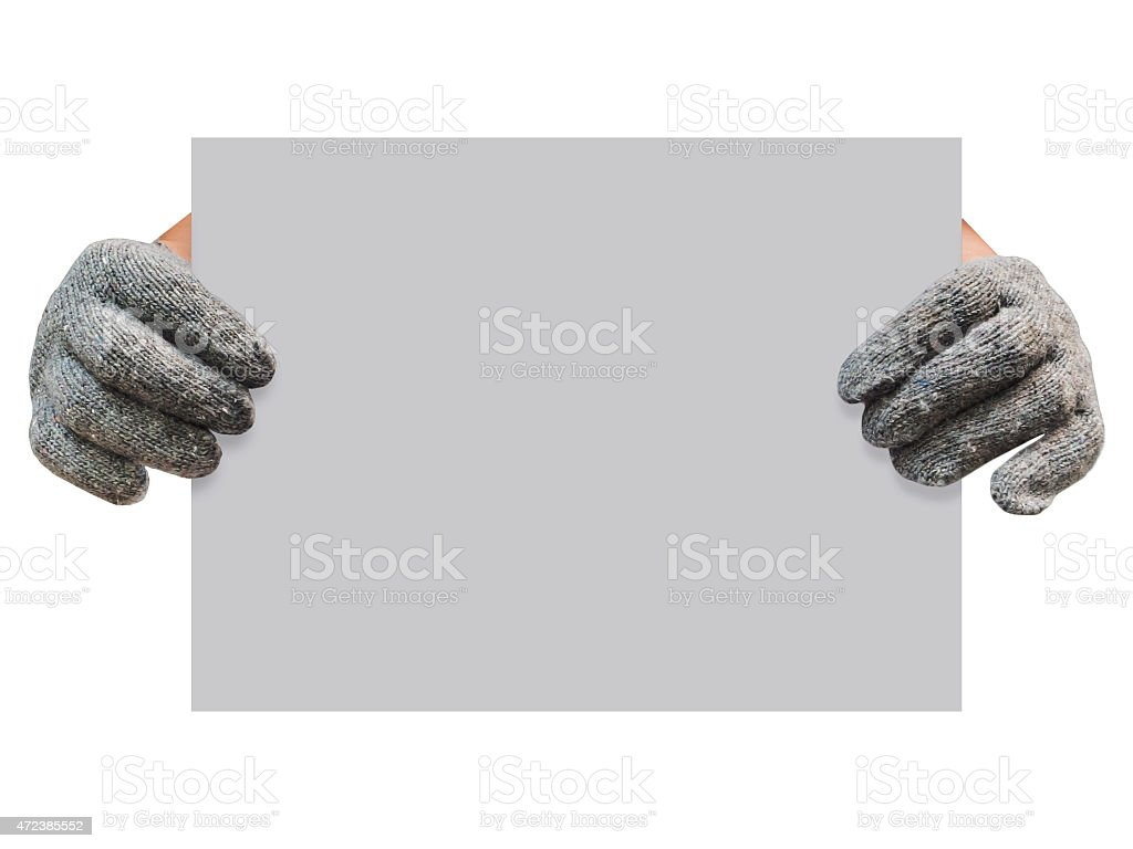 worker gloved hand holding grey board stock photo