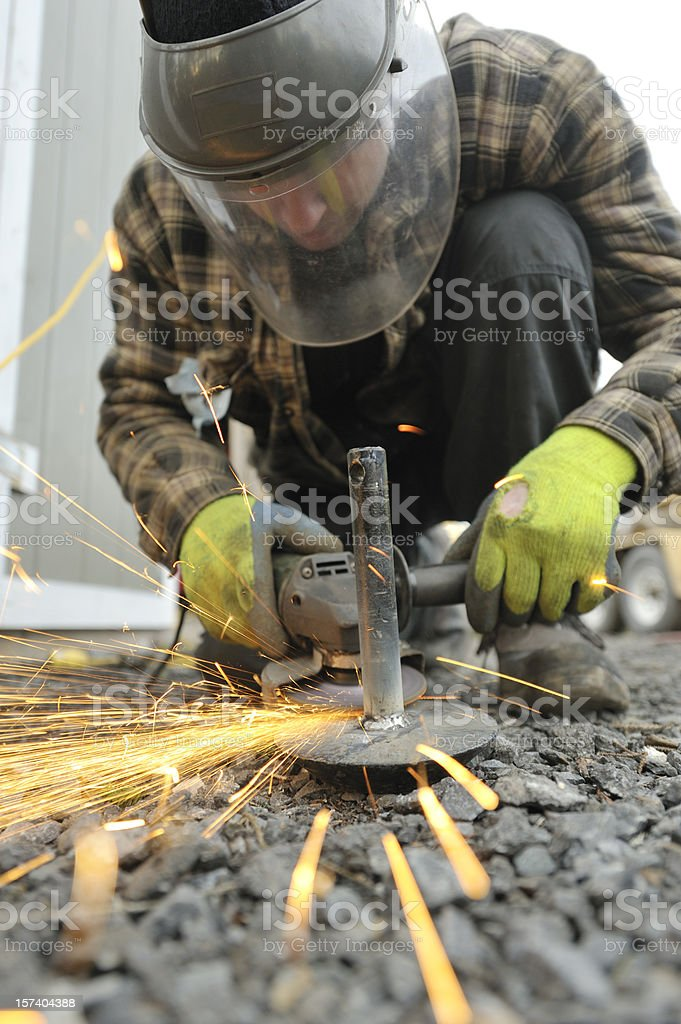 Worker Grinding Metal, Lots of sparks. stock photo