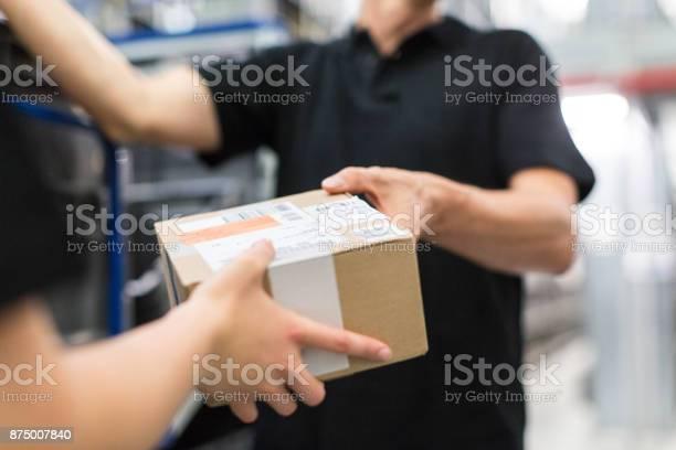 Worker handing over a package to colleague picture id875007840?b=1&k=6&m=875007840&s=612x612&h=cavtsq0daz8aenc4rwuefsslz5qq c9rh3dq2lhvvag=