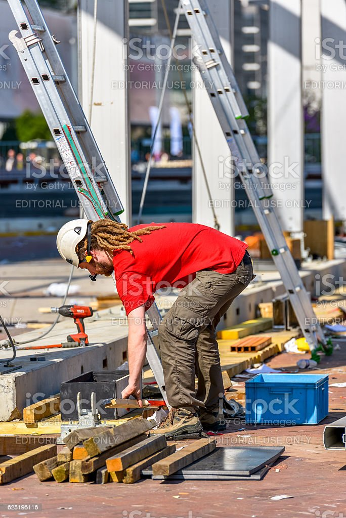 worker handles a wooden cleat stock photo