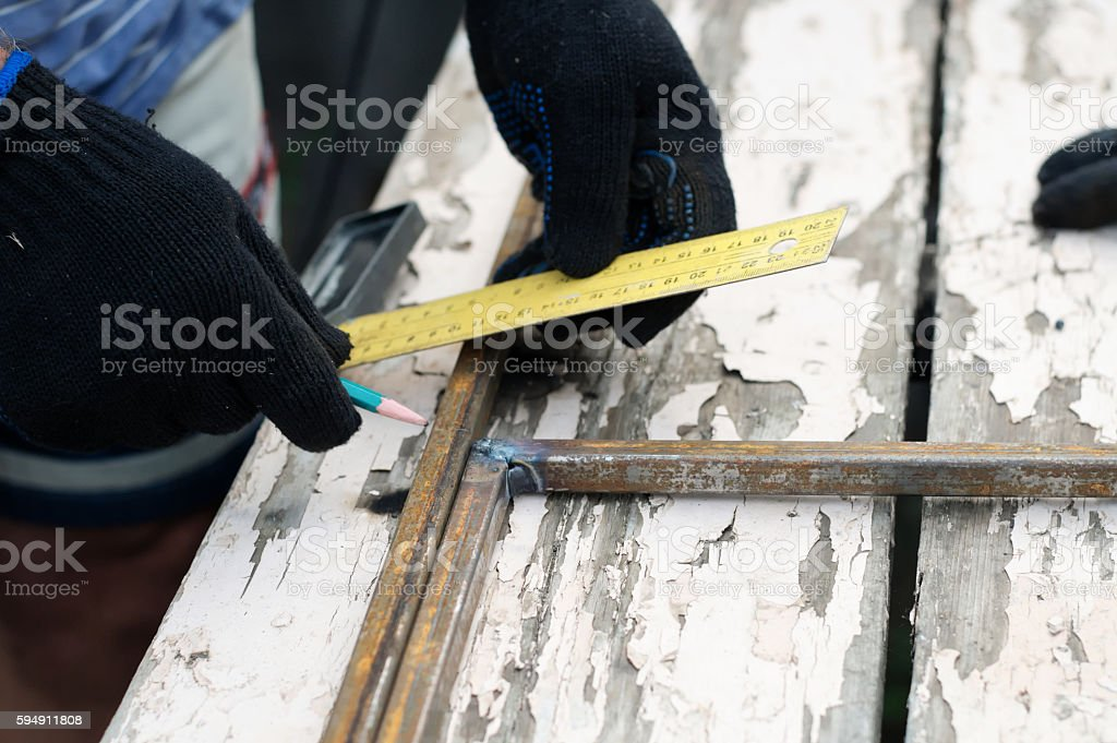Worker hands in protective gloves constructing artwork stock photo