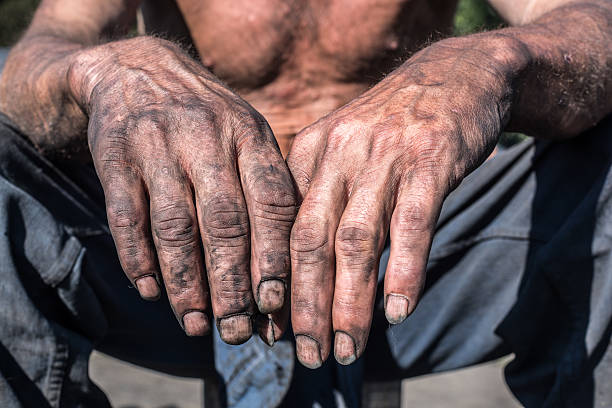 Worker Hands. Charcoal-burners worker man with dirty hands. migrant worker stock pictures, royalty-free photos & images