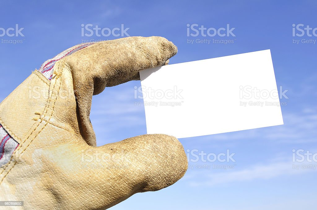 Worker Holding a Blank Business Card royalty-free stock photo