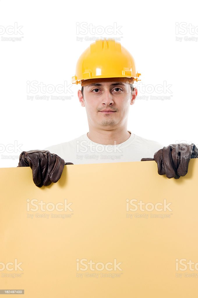 Worker holding a empty board, isolated on white royalty-free stock photo