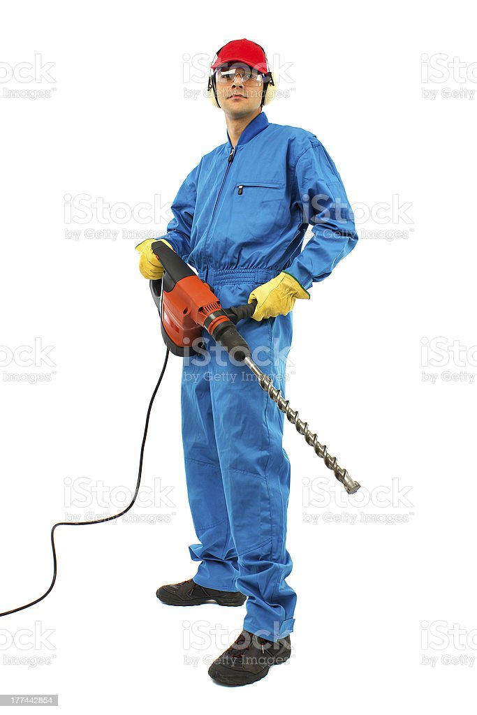 worker holding a power drill stock photo