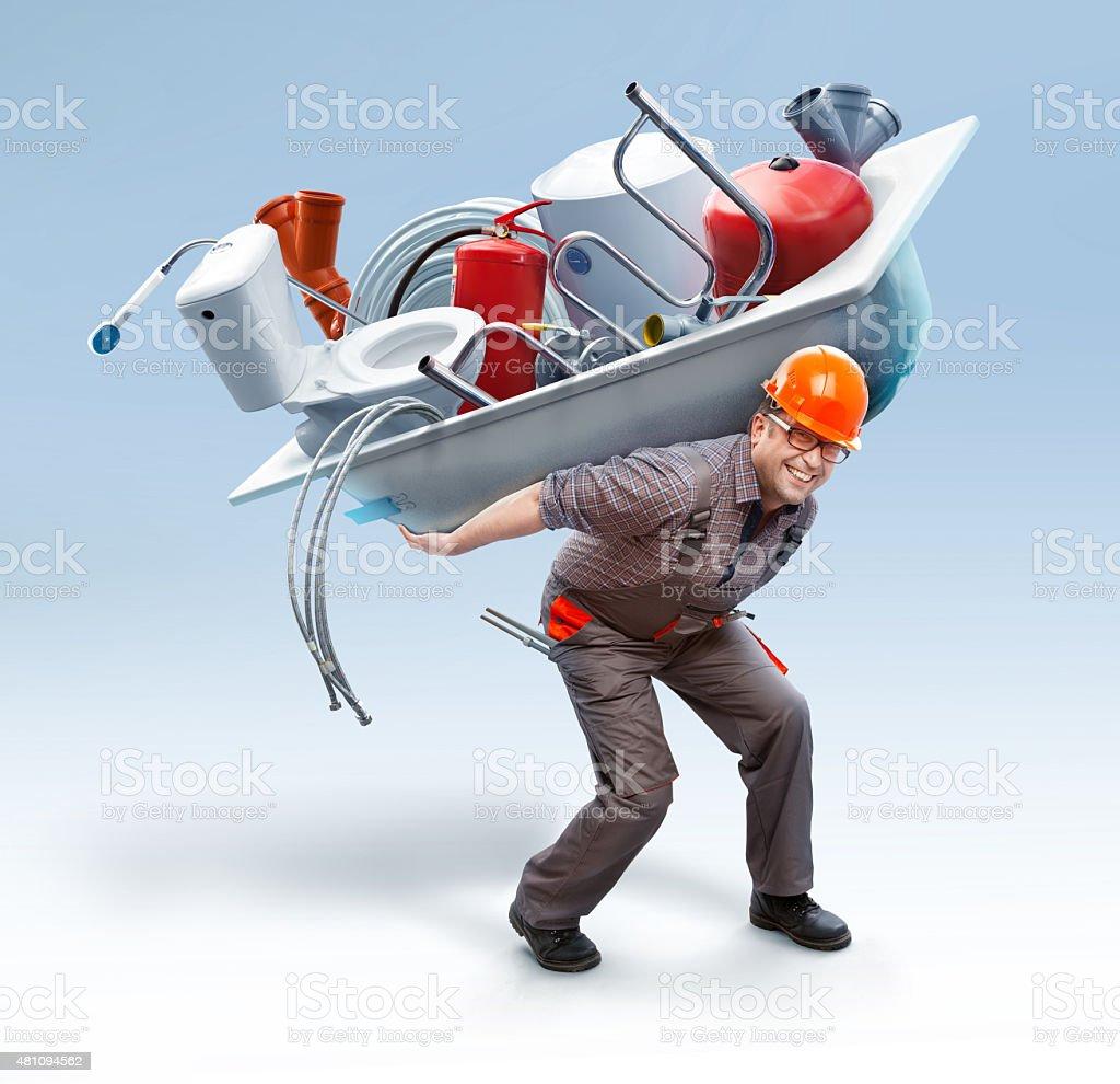 Travailleur tenant une baignoire avec sanitaires ingénierie - Photo