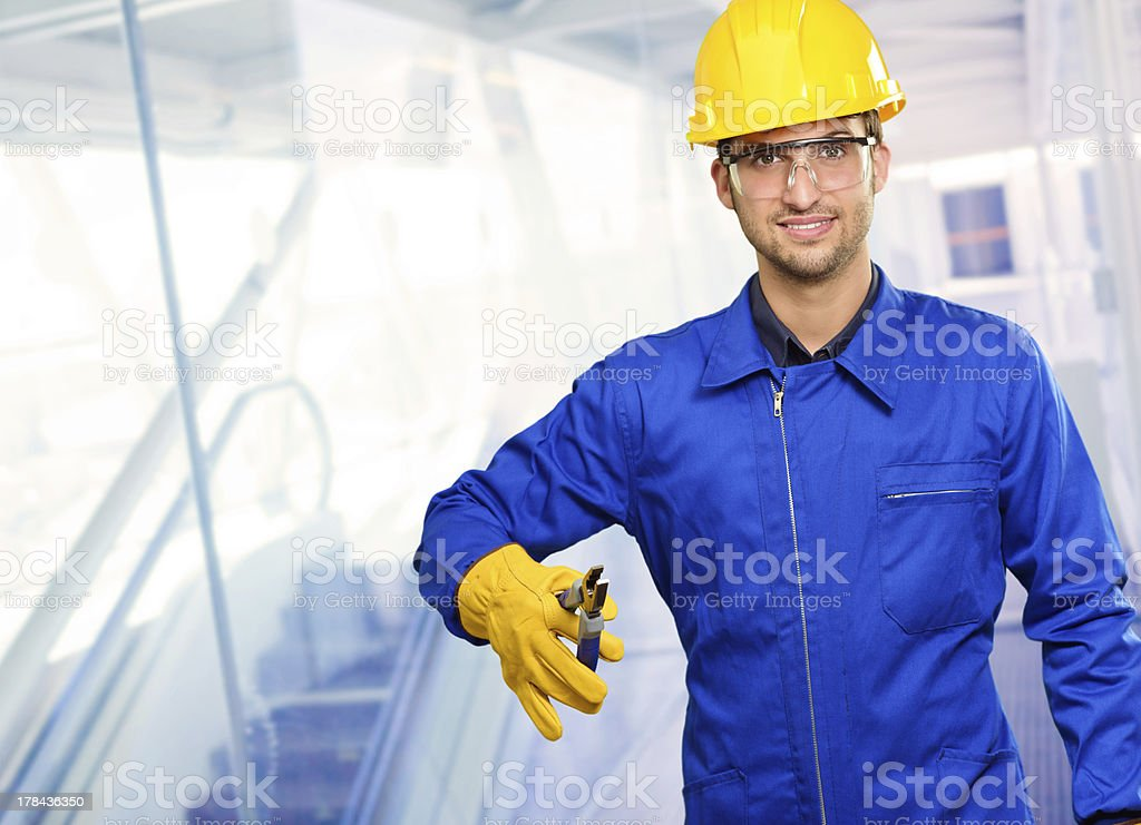 Worker Holding Plier royalty-free stock photo
