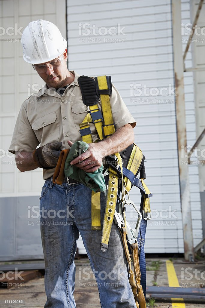 Worker holding safety harness royalty-free stock photo