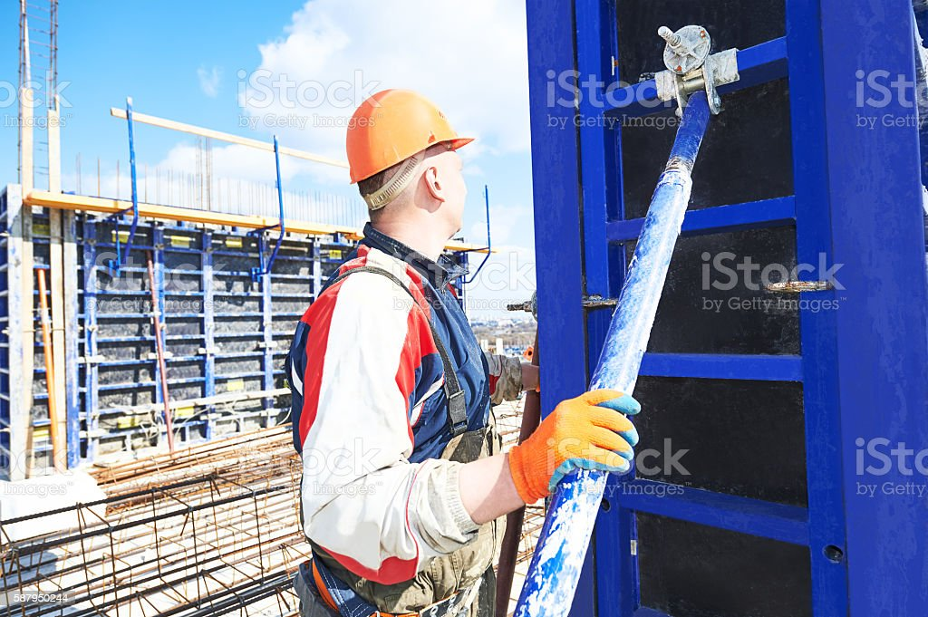 worker holding steel support stock photo