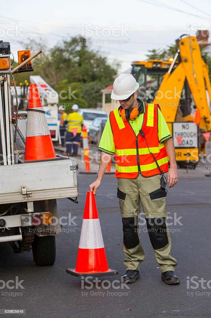 worker holding traffic cone stock photo