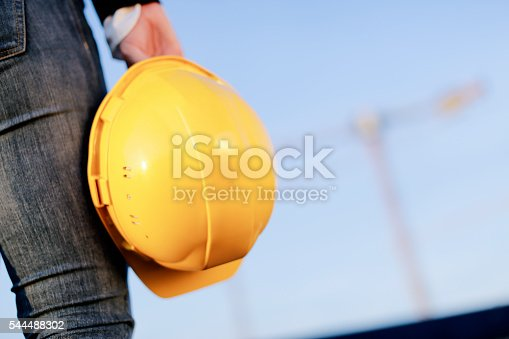 617878058 istock photo Worker holding yellow hemlet at construction site 544488302