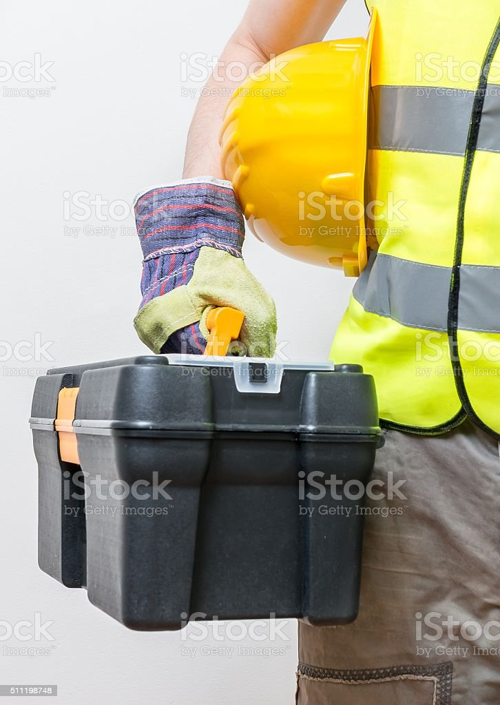 Worker holds toolbox. Construction concept. stock photo