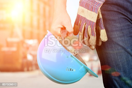 istock Worker in a construction site with blue helmet 837009512