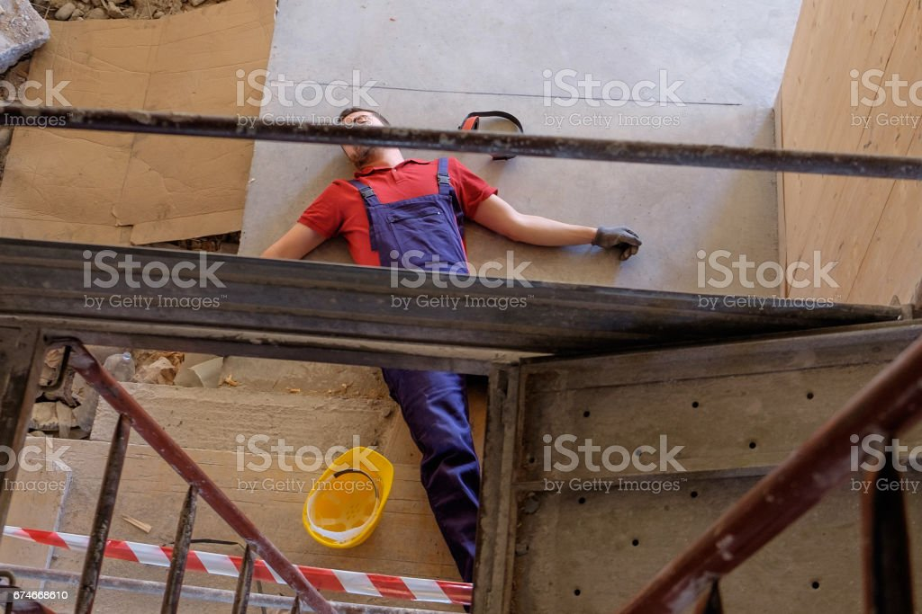 Worker in a faint  after  on-the-job injury stock photo