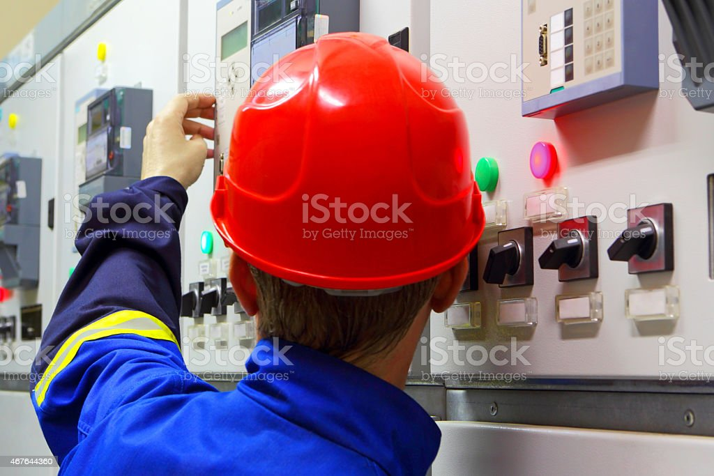 Worker in a helmet, the electrician stock photo