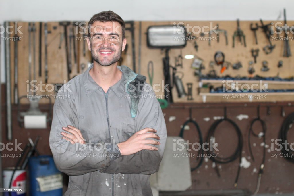 Worker in a repair shop with copyspace stock photo