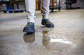 istock A worker in a warehouse walking in spilled liquid. 1025052474