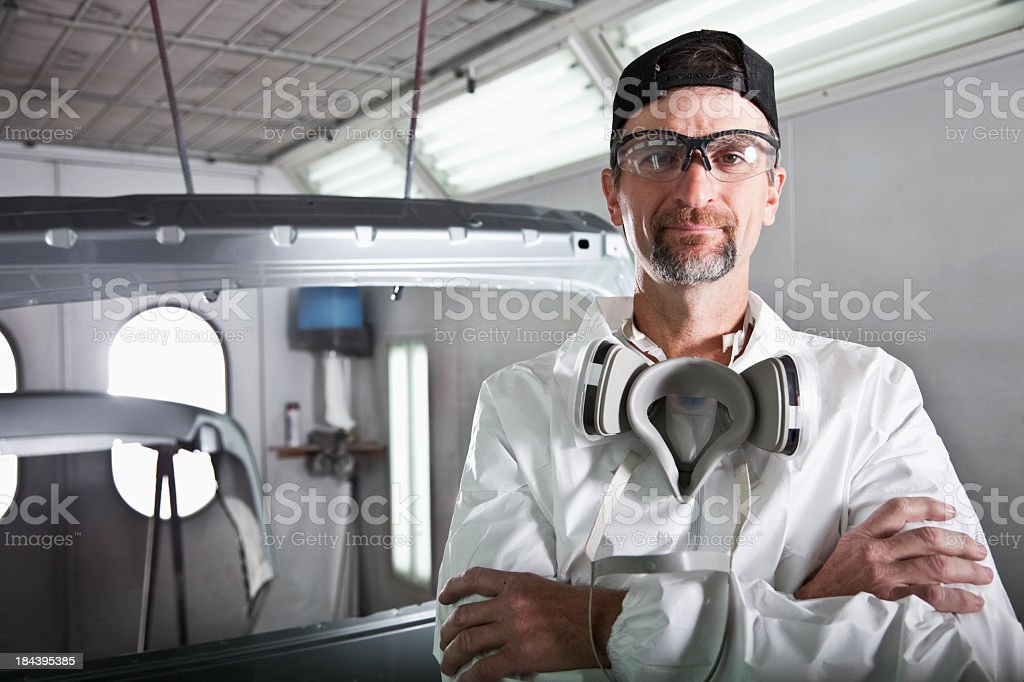 Worker in auto body shop royalty-free stock photo