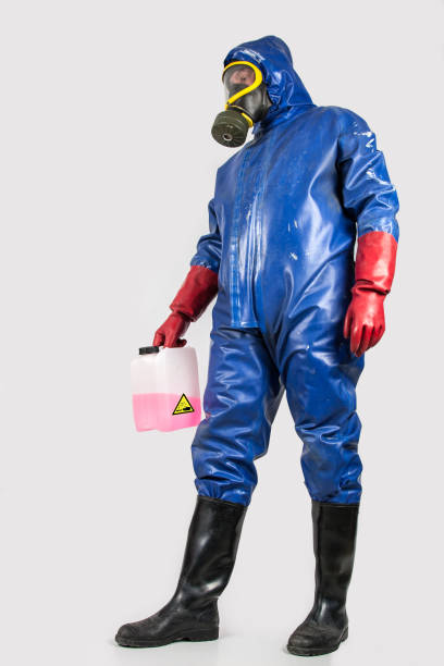 Worker in blue rubber protective suit stock photo