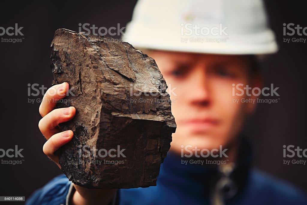 Worker in coal mine stock photo