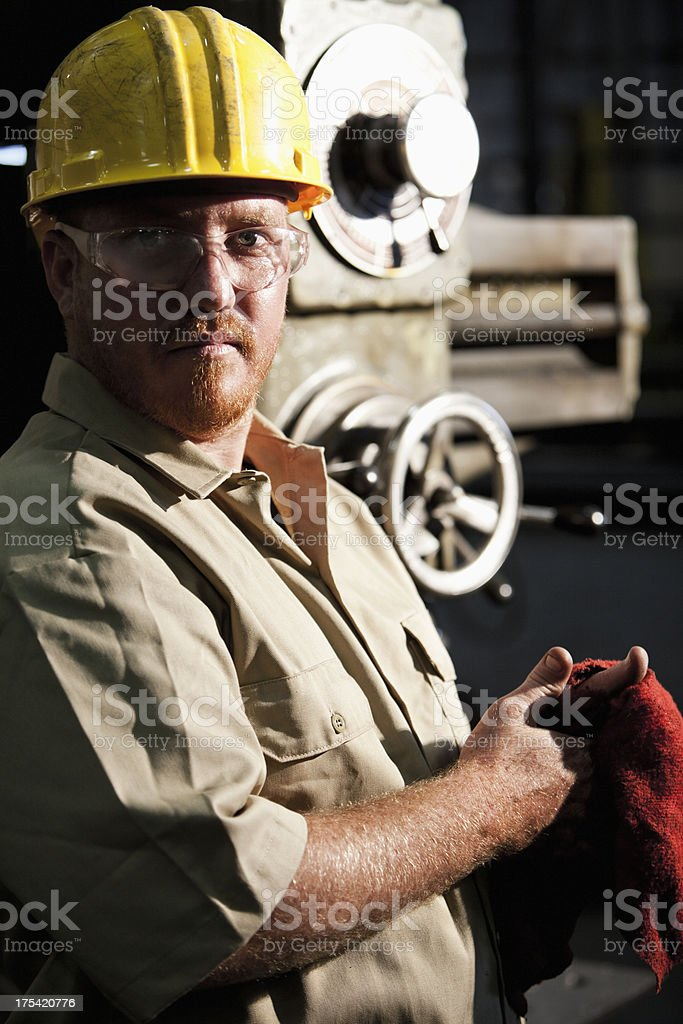 Worker in fabrication shop royalty-free stock photo