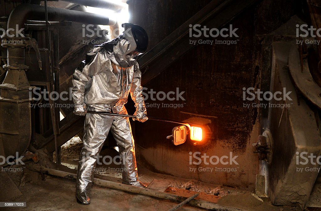 Worker in fireproof suit stock photo