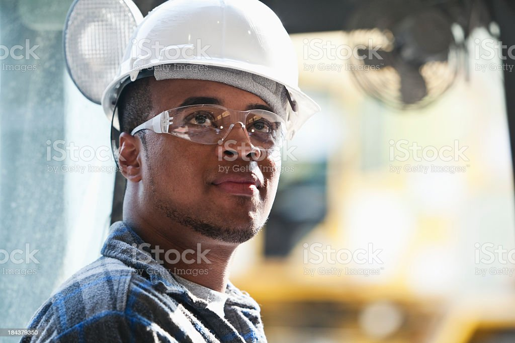 Worker in hardhat and safety glasses royalty-free stock photo