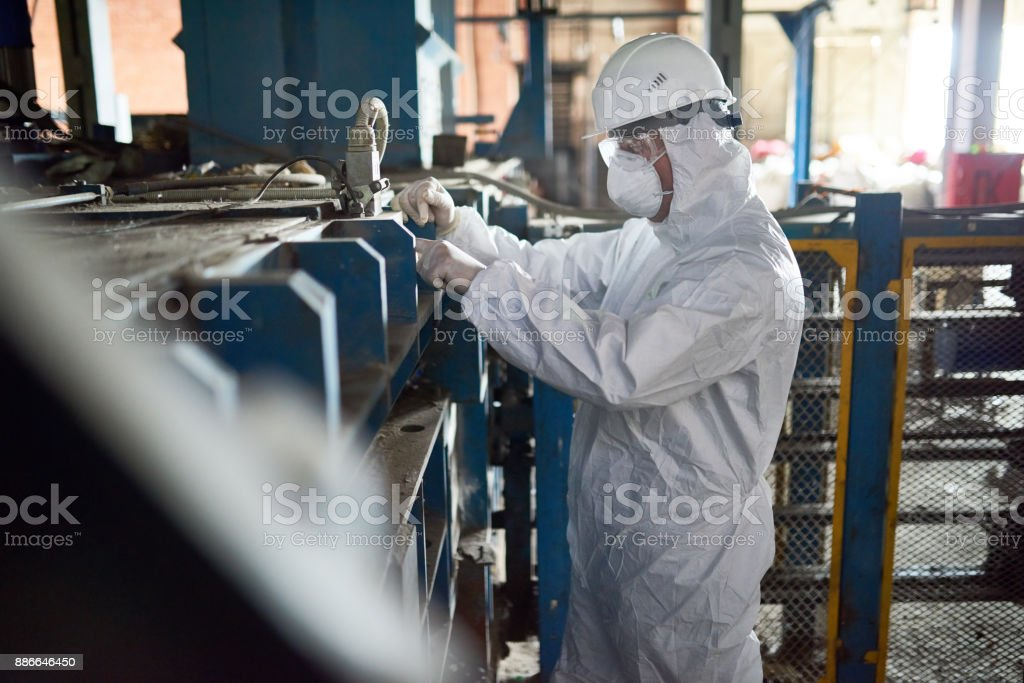 Worker in Hazmat Suits at Modern Factory stock photo