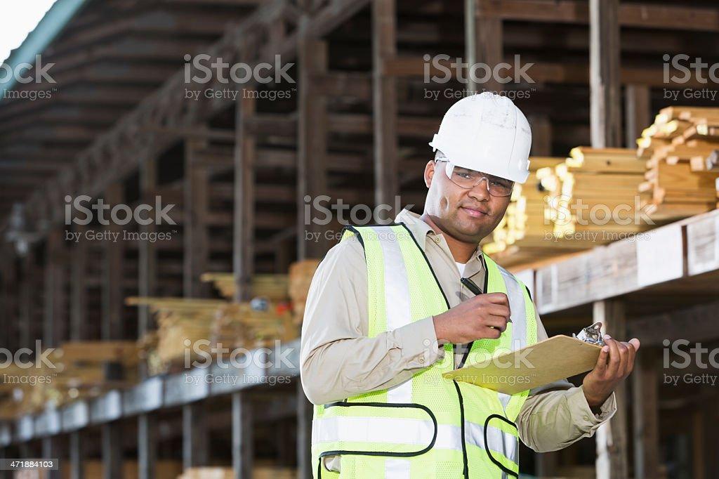 Worker in lumber yard stock photo