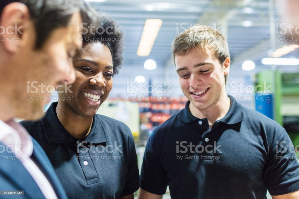 Worker in meeting with colleagues at factory stock photo